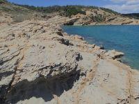 Lopar Ráb plaža Stolac pískovcový útes